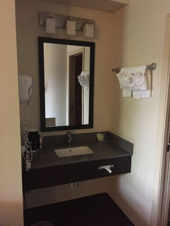 Sleep Inn: sink area with coffee pot and toiletries