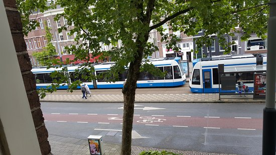 Hotel V Frederiksplein: busy tram stop on the street in front (7 & 10)