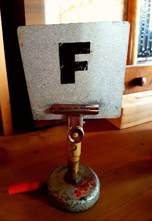 Lincoln, New Zealand: An old bunsen burner used for our table number stand