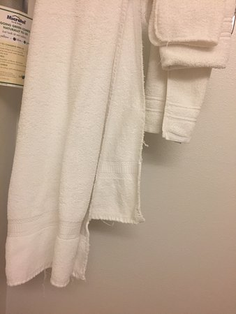 Fond du Lac, WI: Towels were discolored, frayed and very thin.