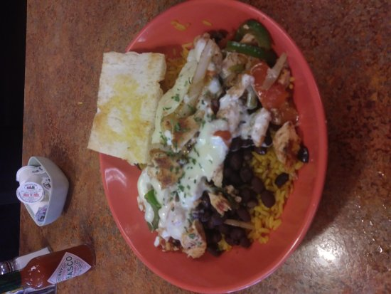 Britt's Cafe: Rice with black beans chicken sauteed onions peppers coverd in cheese