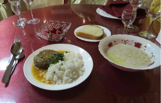 Baikonur, Kazakstan: A memorable breakfast; greasy meat patty with rice, lukewarm porridge, stale bread, pickled sala