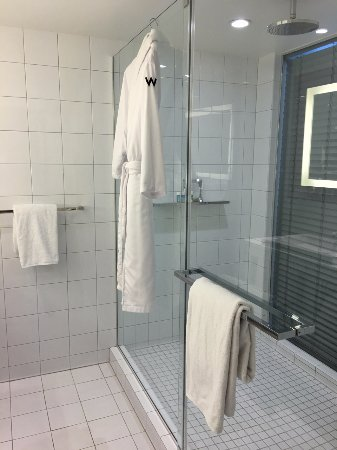 Large Shower With Multiple Heads Window Into Bedroom