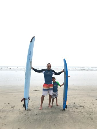 My husband and son after surfing with Nosara Tico Surf School