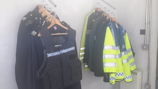 Kirriemuir, UK: Just some of the many uniforms, both old and modern, that our visitors are invited to try on.