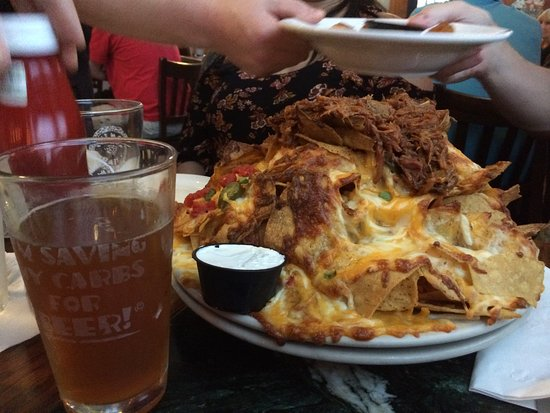 Willimantic, CT: The plate of nachos is much larger than they look in the photo.