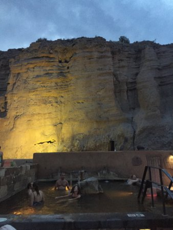 Ojo Caliente, NM: Pools at night with lit up cliffs
