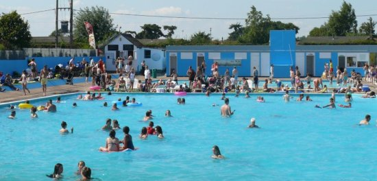 Brightlingsea, UK: one off the Internet looking down the pool, at the toddlers paddling area, shop and changing roo