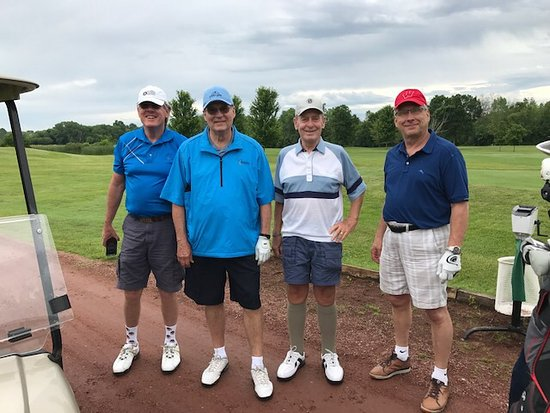 Four friends renew yearly golf date and dinner in Beaver Dam.