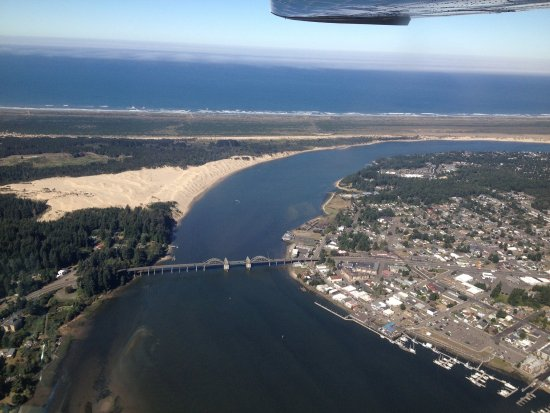 Aerial of the Siuslaw River Bridge, Florence, Oregon (looking west).