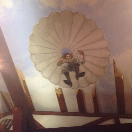 Culpeper, VA: Ceiling of the distillery. Females parachute jumpers are like angels.