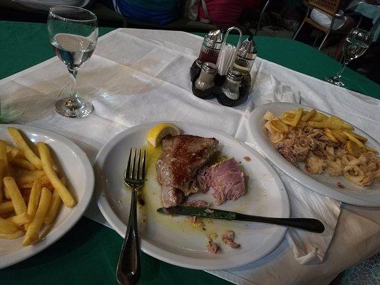 Pirovac, Croatia: Tuna steak and squids, already eaten half of portion