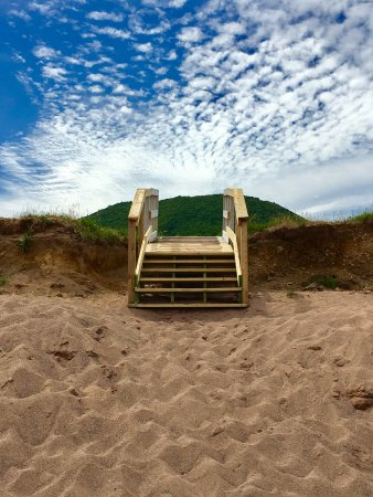 Cape North, Canada: Walkway to the beach with hills in the background