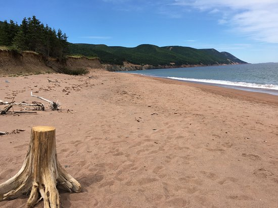 Cape North, Canada: A beautiful beach surrounded by hills