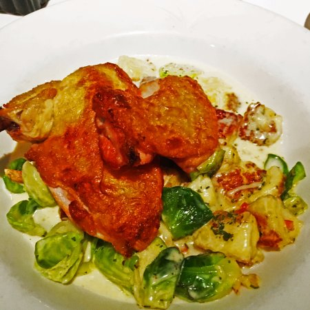 Oakville Grille and Wine Bar: Roasted Honey & Balsamic Chicken with ricotta gnocchi and brussel sprouts. Delicious!