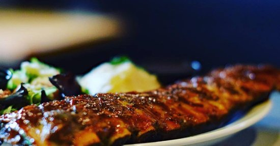 "Houston, Canada: Baby back ribs... an entire rack of ""fall off the bone"" ribs all for yourself plus two sides!"