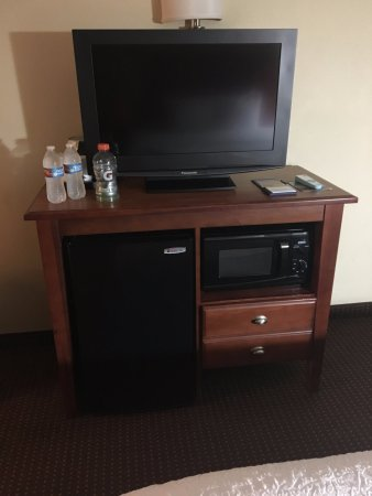TV, microwave and single drawer.