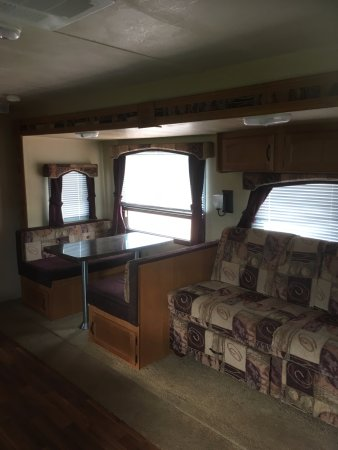 River John, แคนาดา: Jack knife couch and dining area in travel trailer