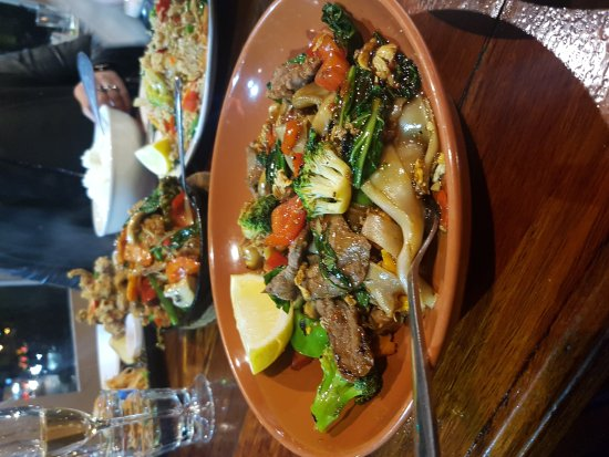 Brighton le Sands, Australia: L-R soft shell crab with pawpaw salad, coconut rice and beef pad kee mao