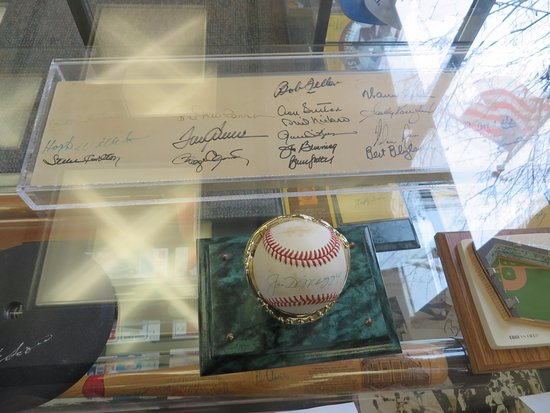 Sharon, PA: My fave: Baseball signed by Joe DiMaggio.  Above are 25 autographs on authentic pitchers rubber.