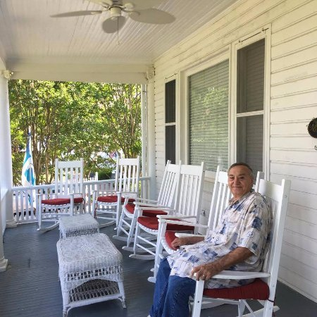Front Porch With Rocking Chairs That Overlook Water Picture Of