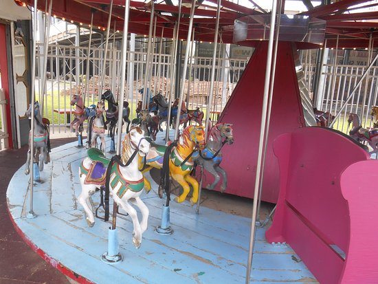 City Island: Three ponies behind a chariot on the Mangels Kiddie Carousel