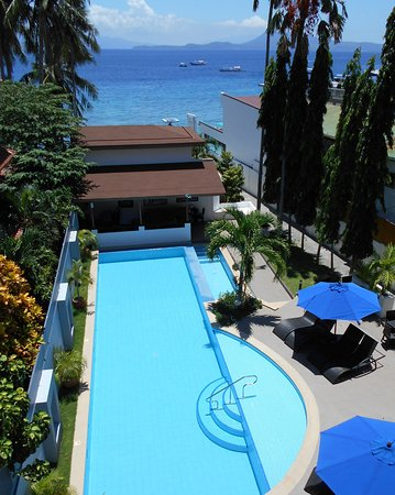 Out of the Blue Resort: Pool and Sea View from The Verandah Restaurant