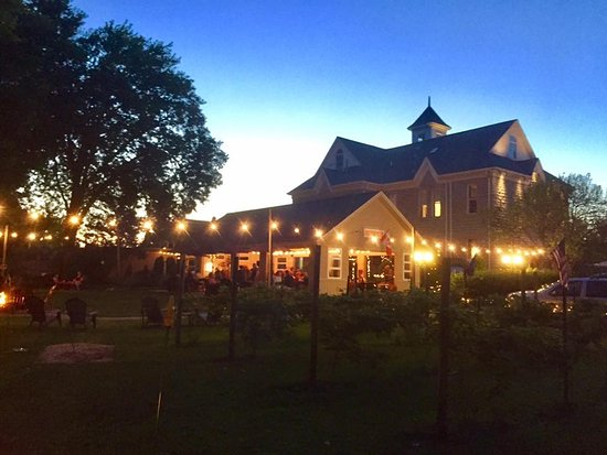 Marblehead, OH: The winery pavilion at sunset featuring fire pits, twinkling patio lights and tiki torches. Amaz