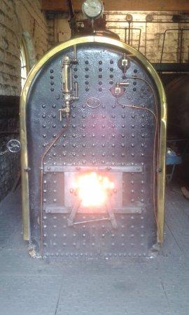 Cromford, UK: Boiler generating steam