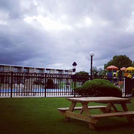Red Lion Hotel Harrisburg Hershey: View from our patio of the huge sparkling outdoor pool and playground. There is also an indoor p