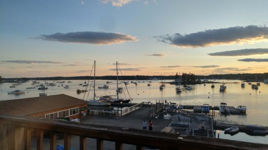 Cap'n Fish's Waterfront Inn: This is the view from the top deck overlooking the harbor nearing sunset August 2017