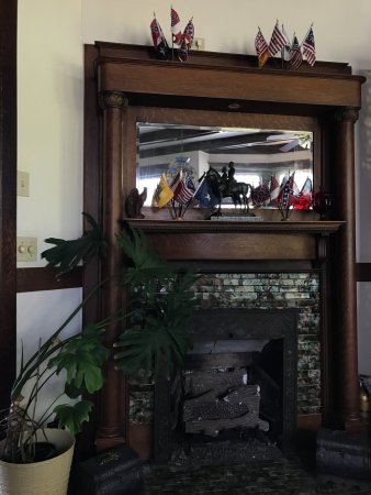 Stonewall Jackson Inn: The fireplace in the main common area. Yeah... confederate flags... I know...