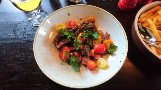 Piteå, Sverige: Tage restaurant at Kust - GRILLED FLANK STEAK WITH CHIMICHURRI, TOMATO SALAD AND FRENCH FRIES