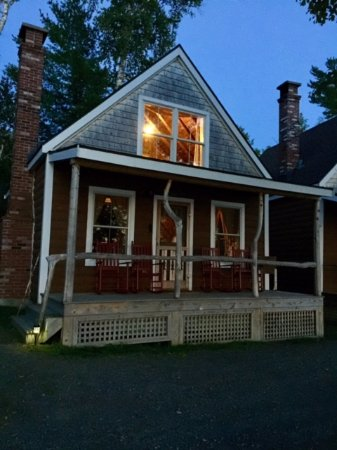 Oquossoc, ME: One of the camps aglow on a late summer evening