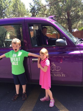 Hotel Santa Fe: Our little girl wanted to ride in the purple car with the jump seats instead of the short bus, s