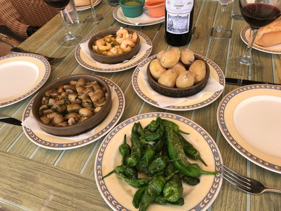 Restaurante Volcan De Timanfaya : Shrimps with garlic, Canarian potatoes, mushrooms with garlic and pimientos del padron