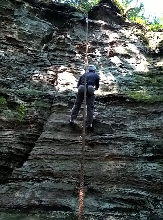 Rockbridge, OH: taking a break on a 80' rock climb near the top to scope out my path