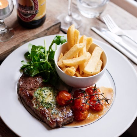 Milton Common, UK: Our 8oz sirloin steak with roasted vine tomatoes, chips, and garlic butter