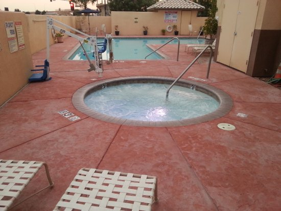 Hot tub with L-Shaped pool beyond