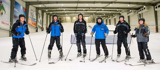 Snowplanet : Group of skiers enjoying their time on the slope