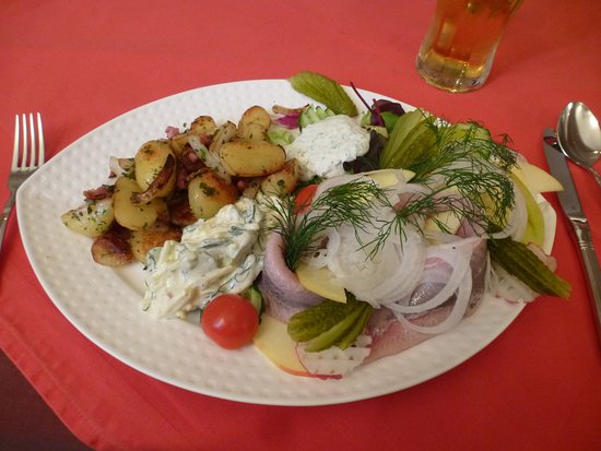 "Neubrandenburg, Germany: ""Matjesfilet Nordic Style"" with pan-fried potatoes"