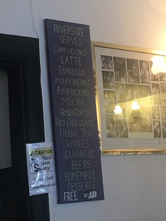 Riverside Restaurant Bed & Breakfast: A little drinks menu on the wall #you'rewelcome 😂
