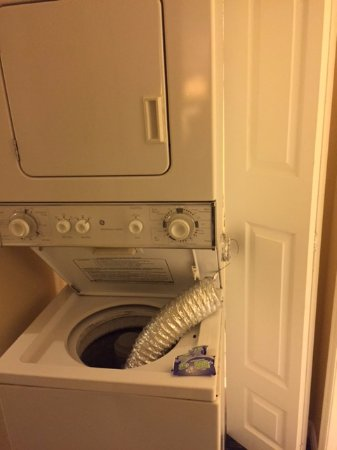 Fantasy World Club Villas: this is the broken washer dryer that sat for over 48 hours after we were in the room