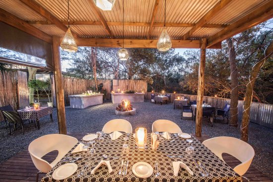 Outdoor boma dining area, Makakatana Bay Lodge, iSimangaliso Wetland Park