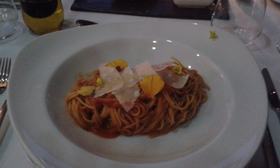 Wellington, South Africa: Classical Spaghetti with Pomodoro Sauce adorned by Parmesan and flower petals - An Exquisite Dis