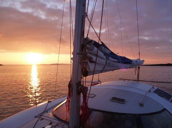 Vlychada, Greece: sunset catamaran cruise in santorini