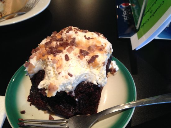Calais, ME: molten chocolate cake with flavored whipped cream frosting, Heath bar bits and caramel sauce