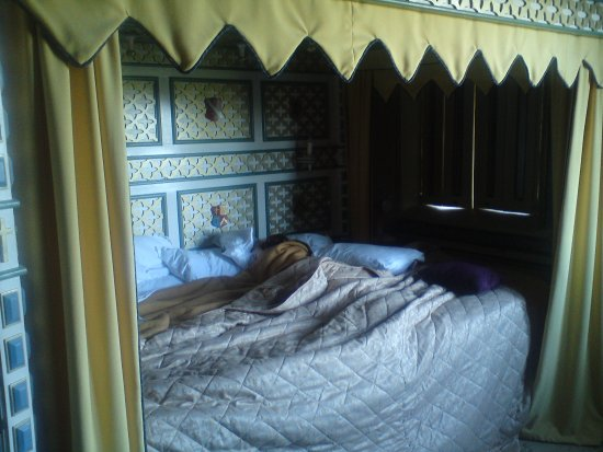 """Thornbury, UK: My new 4' 11"""" fiancee asleep in the 10' wide four poster bed in the Tower."""