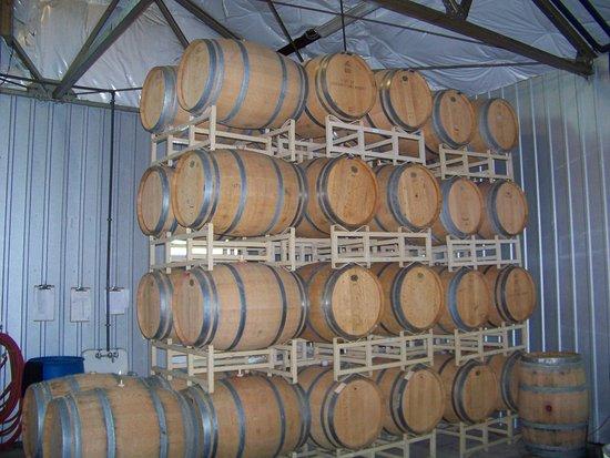 Port of Leonardtown Winery: The wood barrels inside the winery