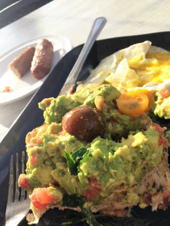 Lake Worth, FL: Smashed Avocado with Tomato, Fresh Parsley in Lime on house-made Multigrain Bread with Eggs & Sa